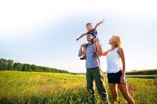 bigstock-happy-family-having-fun-outdoo-18400457